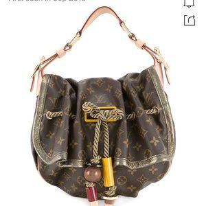 Louis Vuitton Kalahari PM with brass hardware.